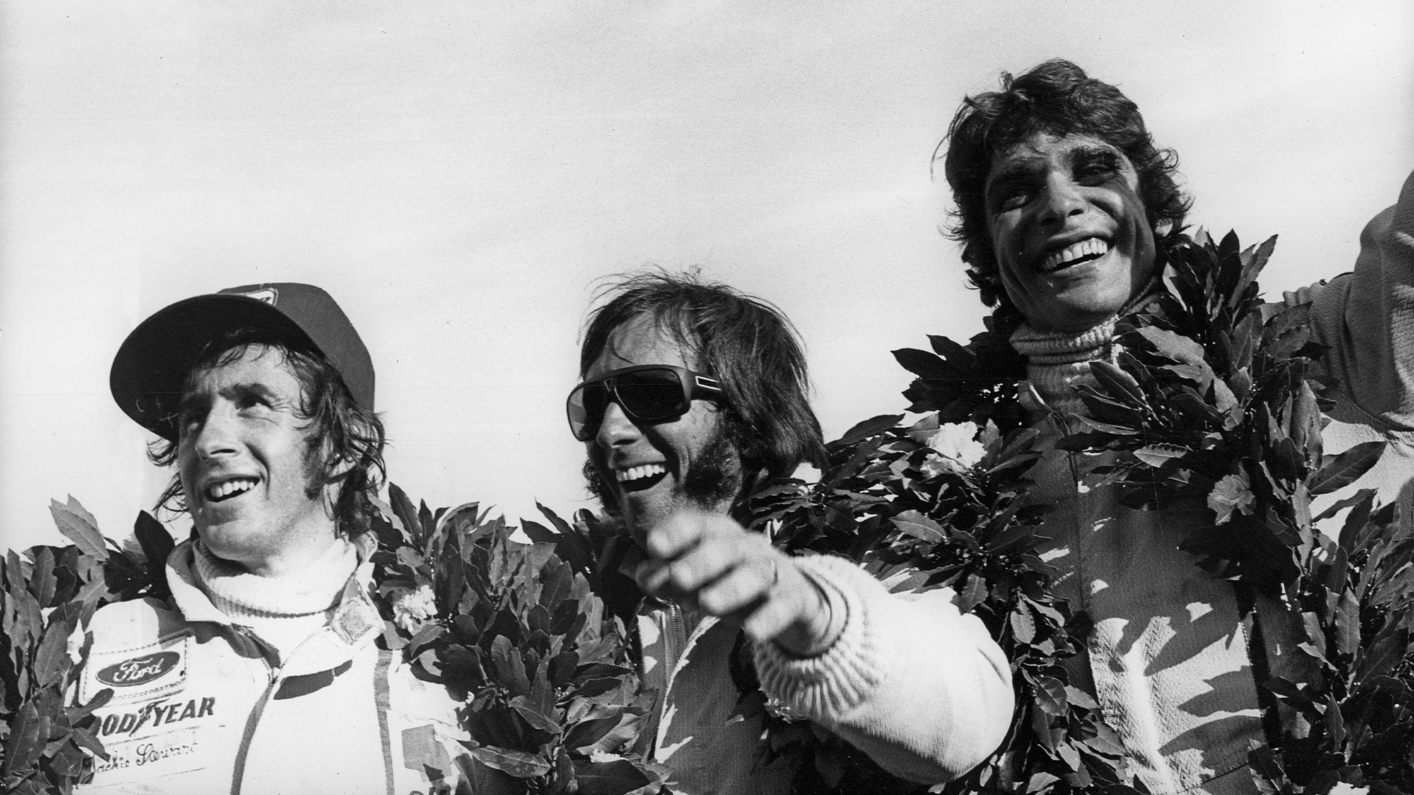Emerson Fittipaldi Francois Cevert and JAckie Stewart on the podium at the 1973 Argentinian Grand Prix