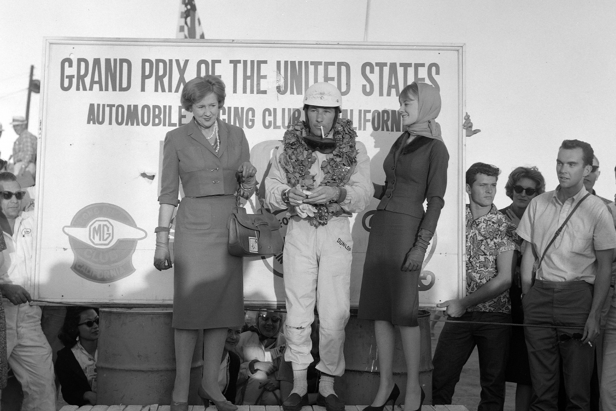 Moss celebrates on the podium