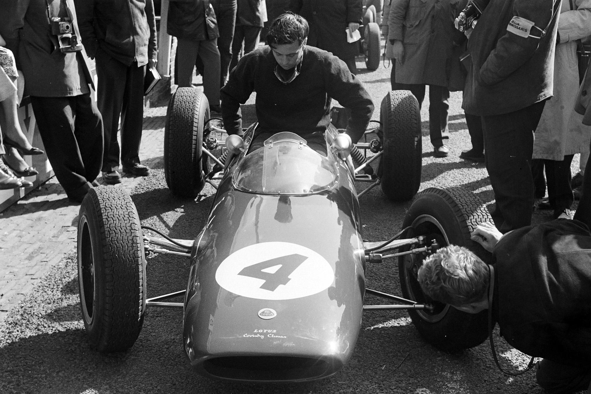 Jim Clark lowers himself into the new Lotus 25