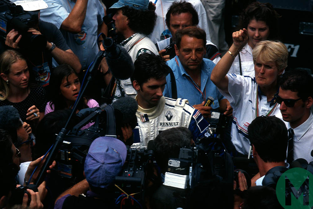 Damon Hill surrounded by press