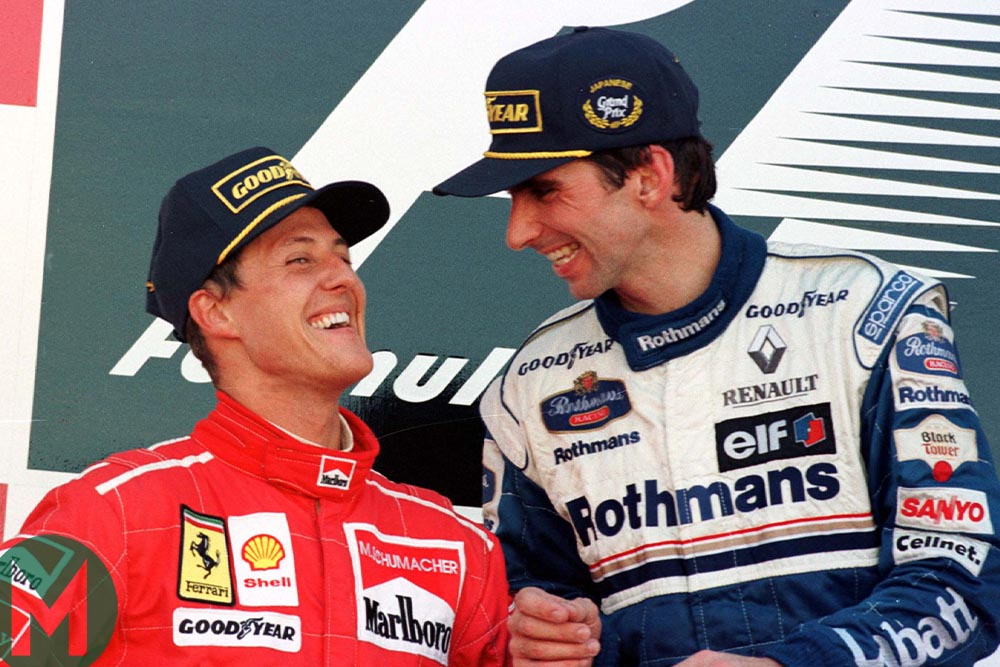 Michael Schumacher and Damon Hill smiling together on the Japanese Grand Prix podium