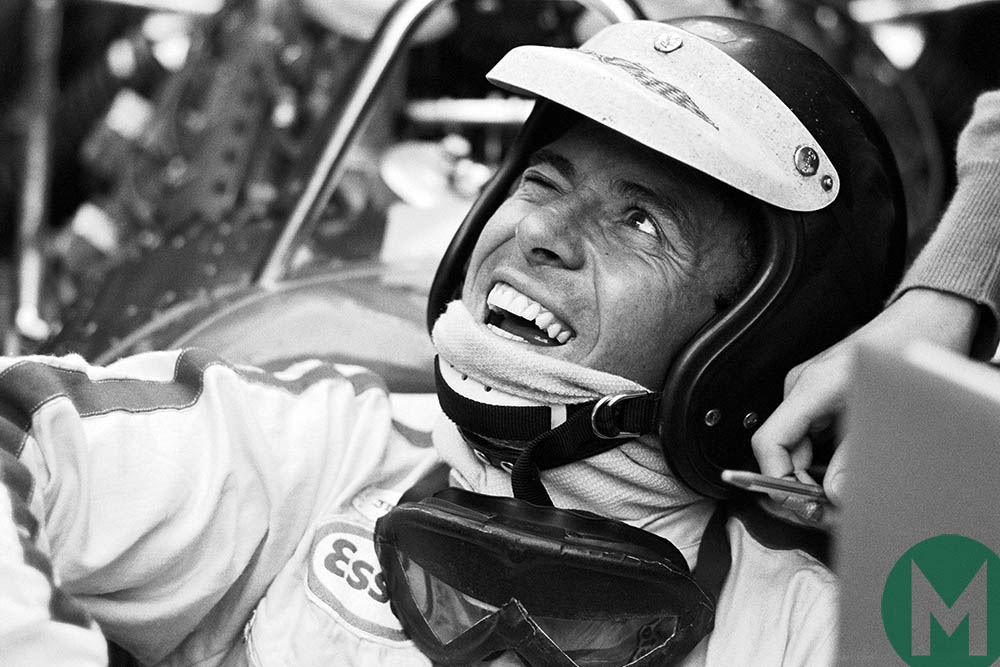 Jim Clark smiles up from the cockpit of his Lotus Formula One car