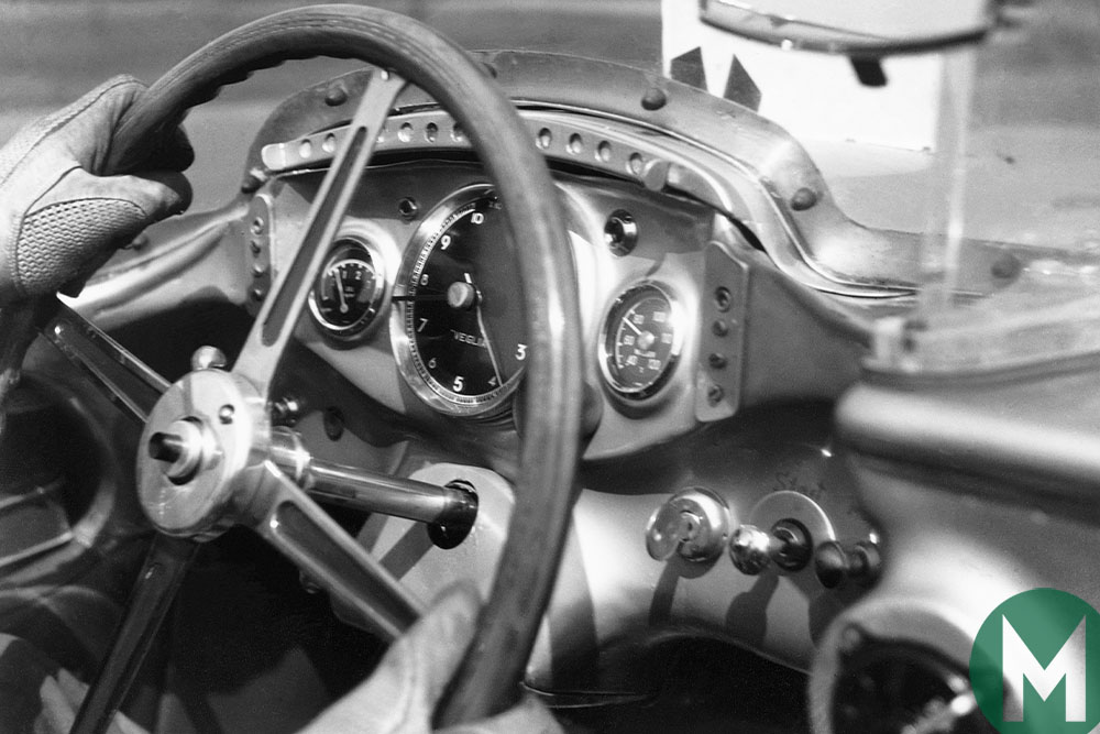Stirling Moss with hands on the wheel of the Mercedes SLR