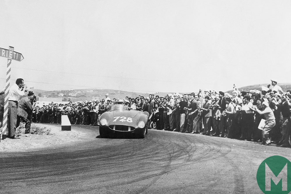 Taruffi rounds hairpin bend in front of spectators 1955 Mille Miglia Italy