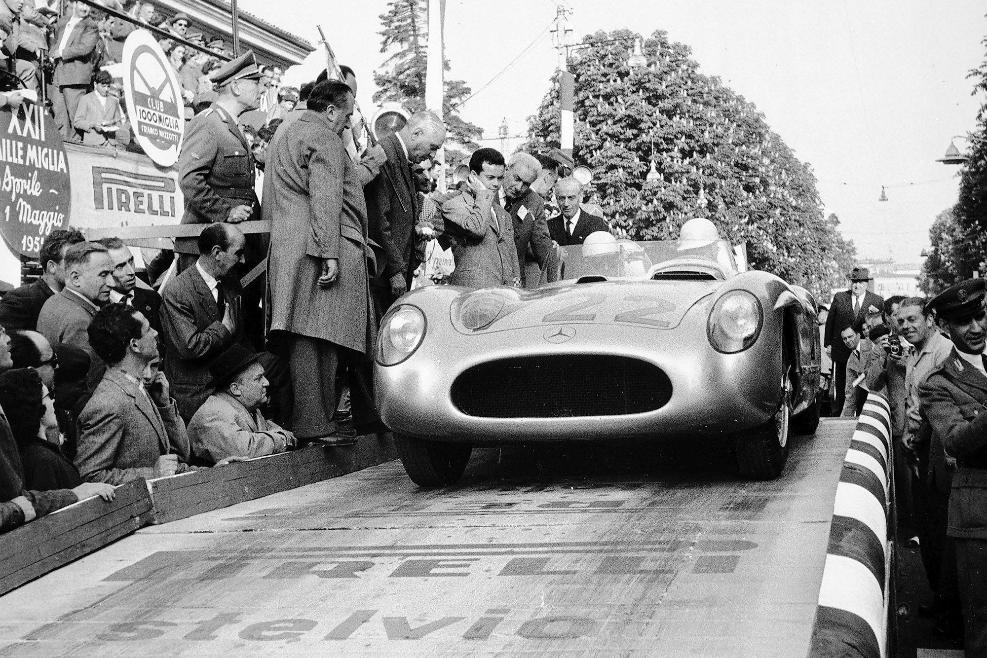 Stirling Moss and and Denis Jenkinson roll off at start of 1955 Mille Miglia Italy
