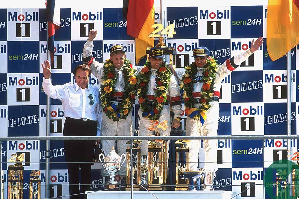 Michele Alboreto celebrates on 1997 Le Mans podium with Porsche team mates Stefan Johansson and Tom Kristensen