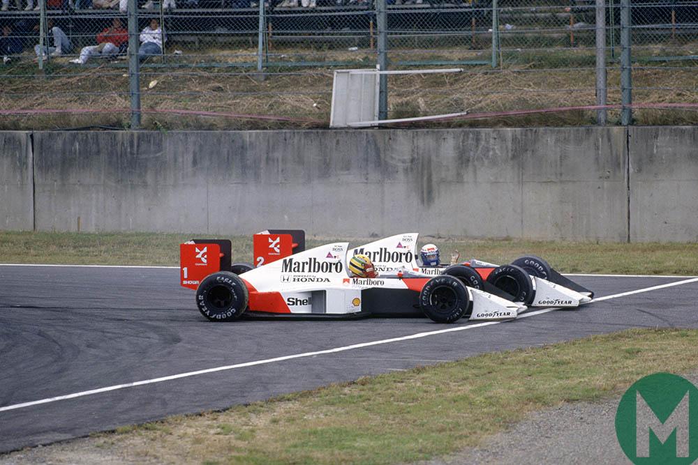 Ayrton Senna and Alain Prost crash their McLaren-Hondas into one another at the 1989 Japanese Gran Prix