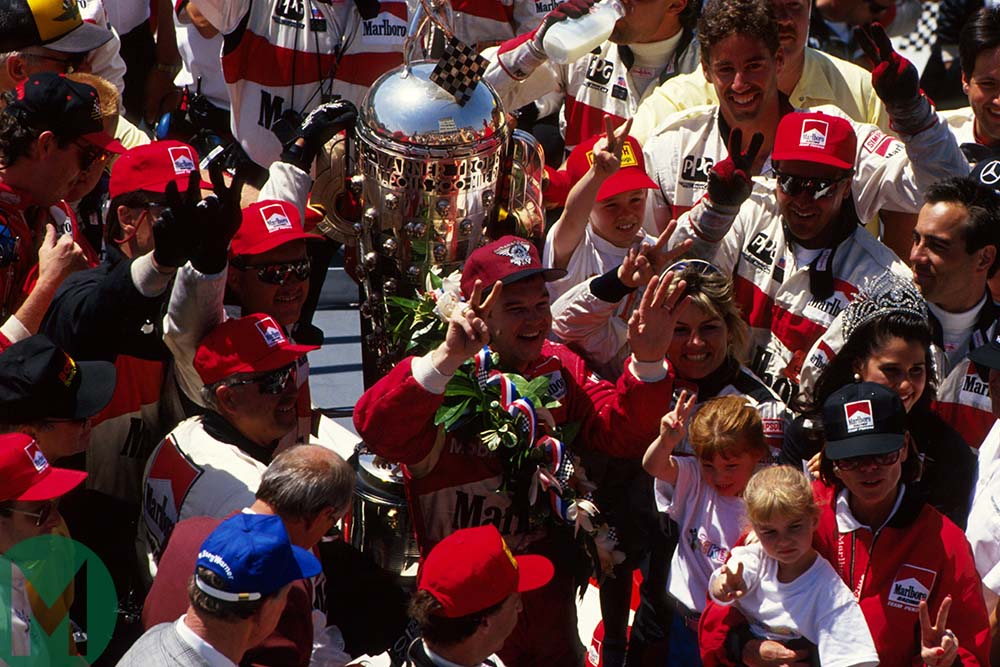 Al Unser celebrates winning the 1994 Indy 500 at Indianapolis Motor Speedway for Penske