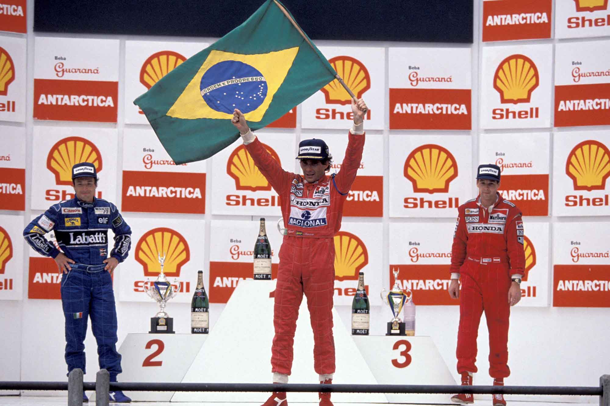 Ayrton Senna on the podium with Riccardo Patrese and Gerhard Berger