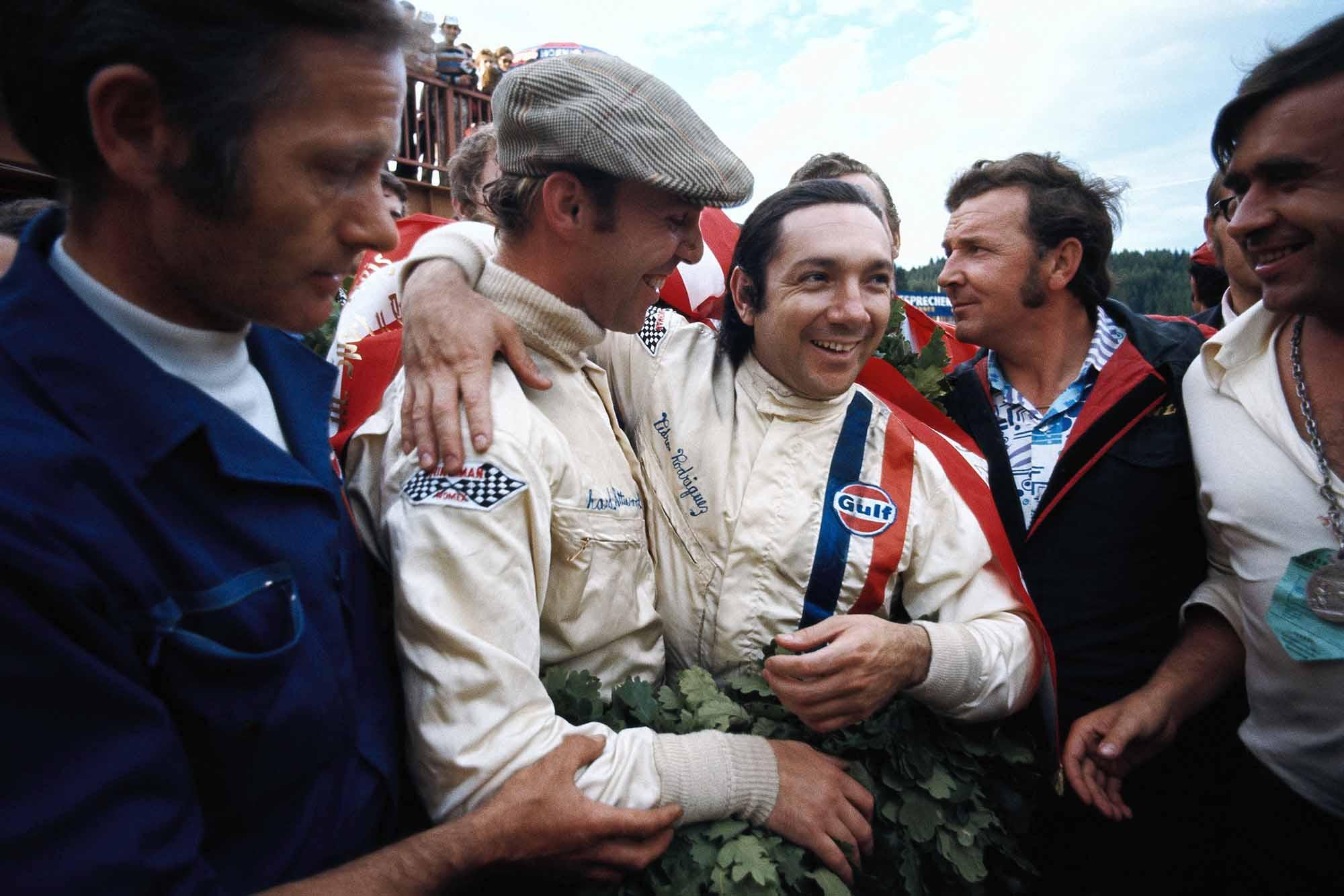 Pedro Rodriguez and Richard Attwood celebrate winning the Austrian 1000km in their Porsche 917