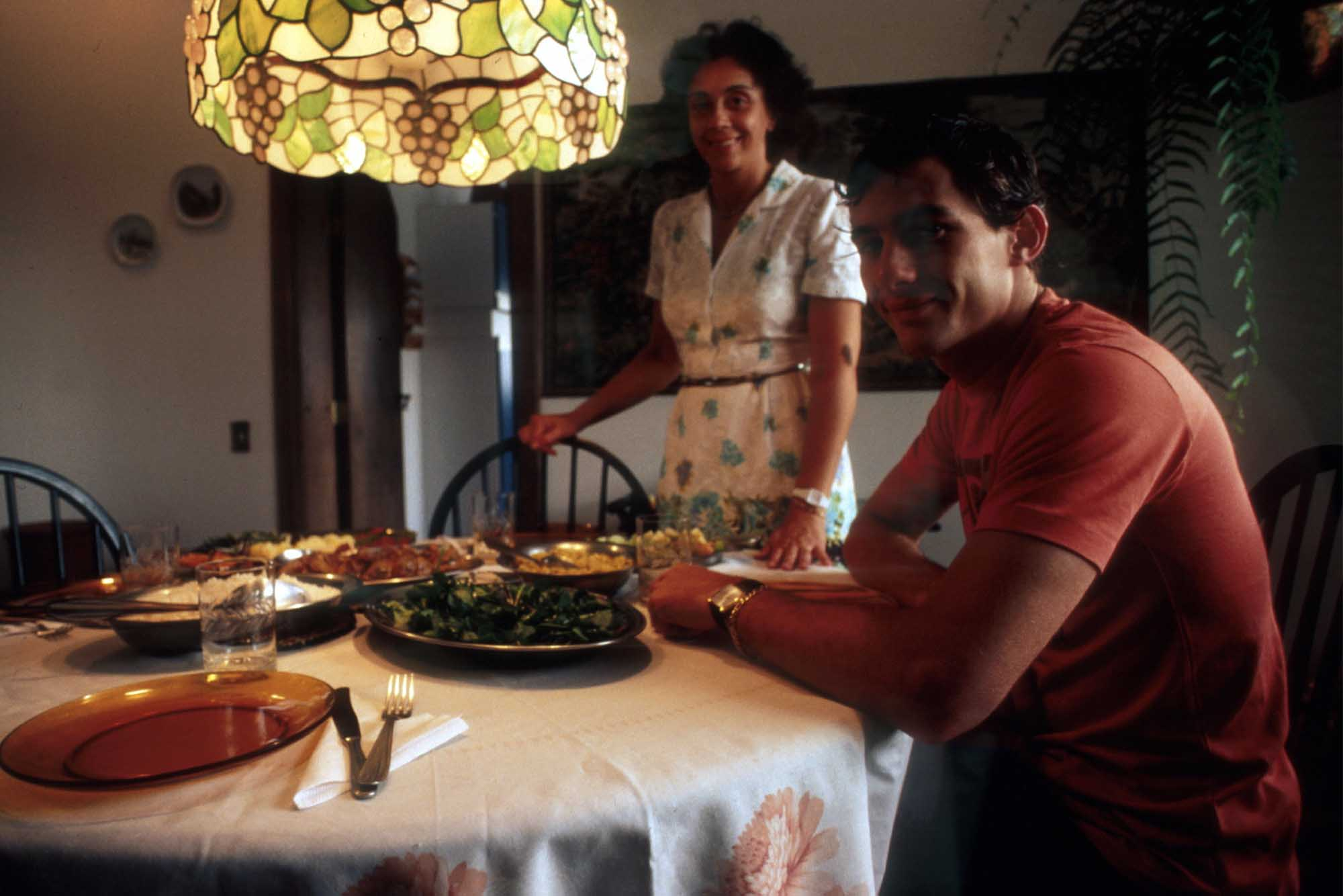 Ayrton Senna sitting down to lunch with his mother Neide Brazil 1984