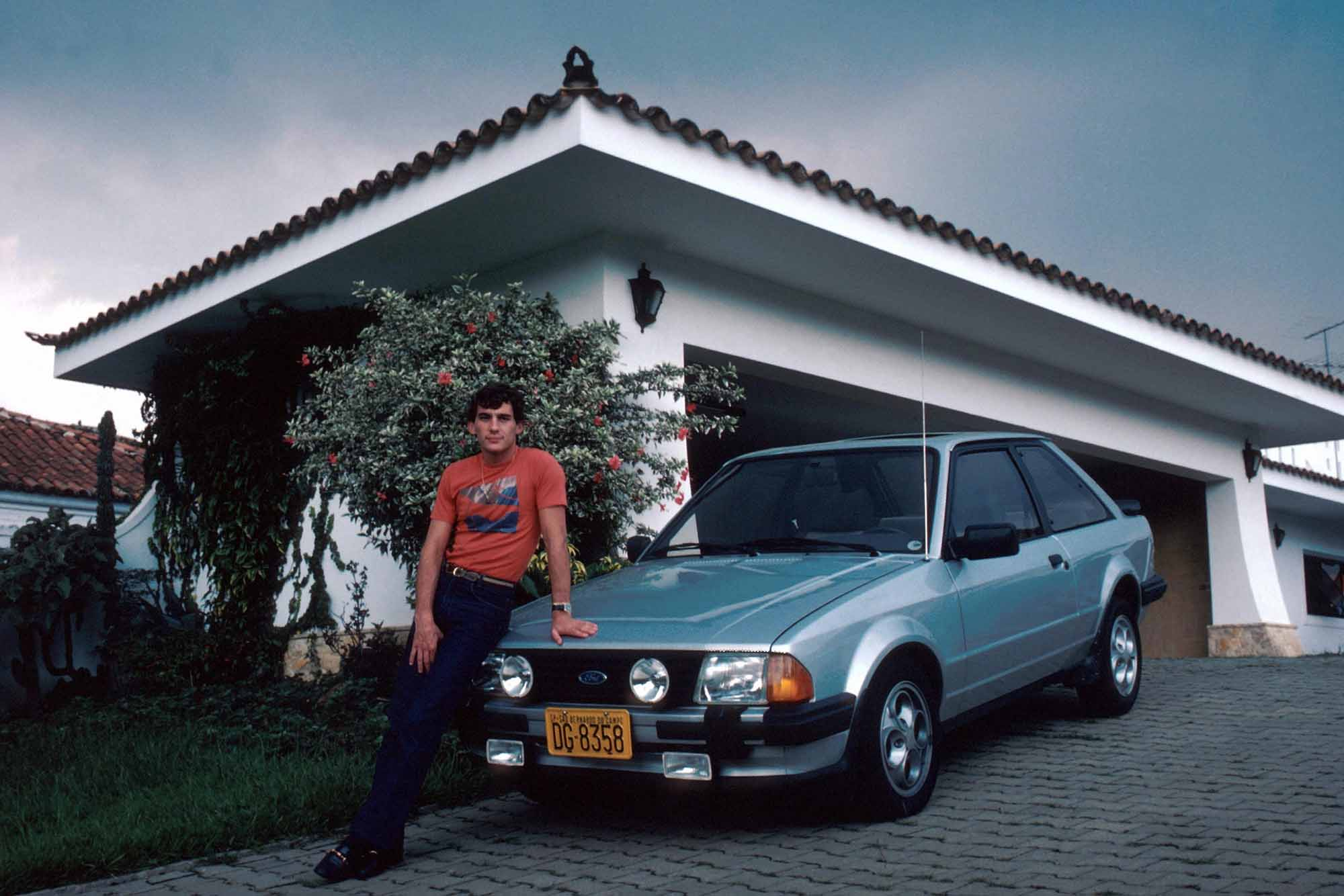 Ayrton Senna with his Ford Escort XR3 outside his family home in Brazil