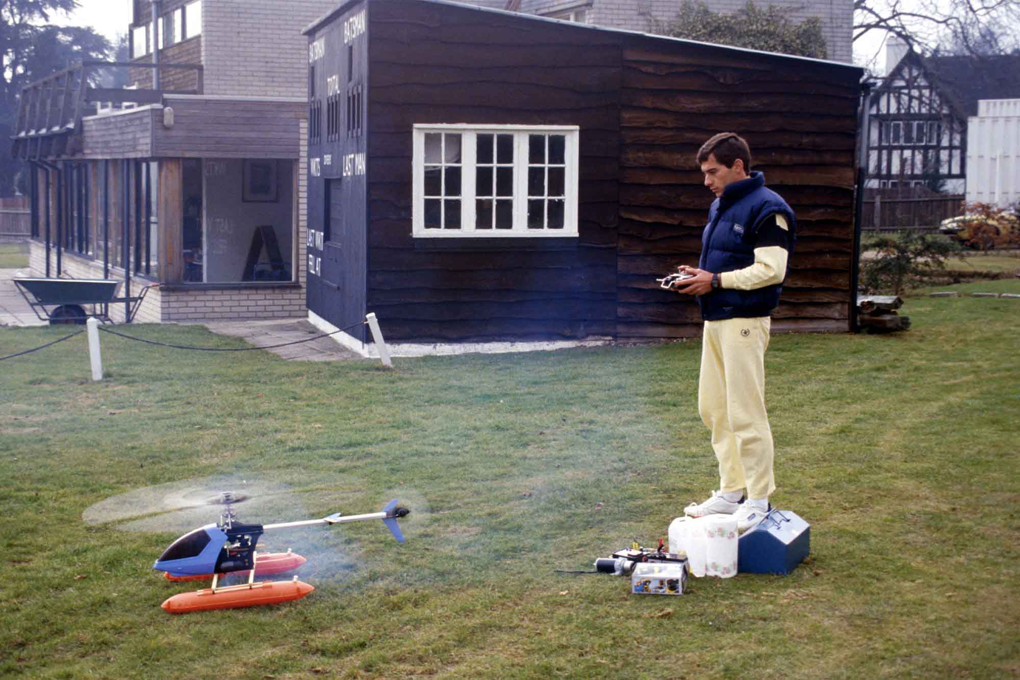 Ayrton Senna flies his model helicopter at home in Esher Surrey