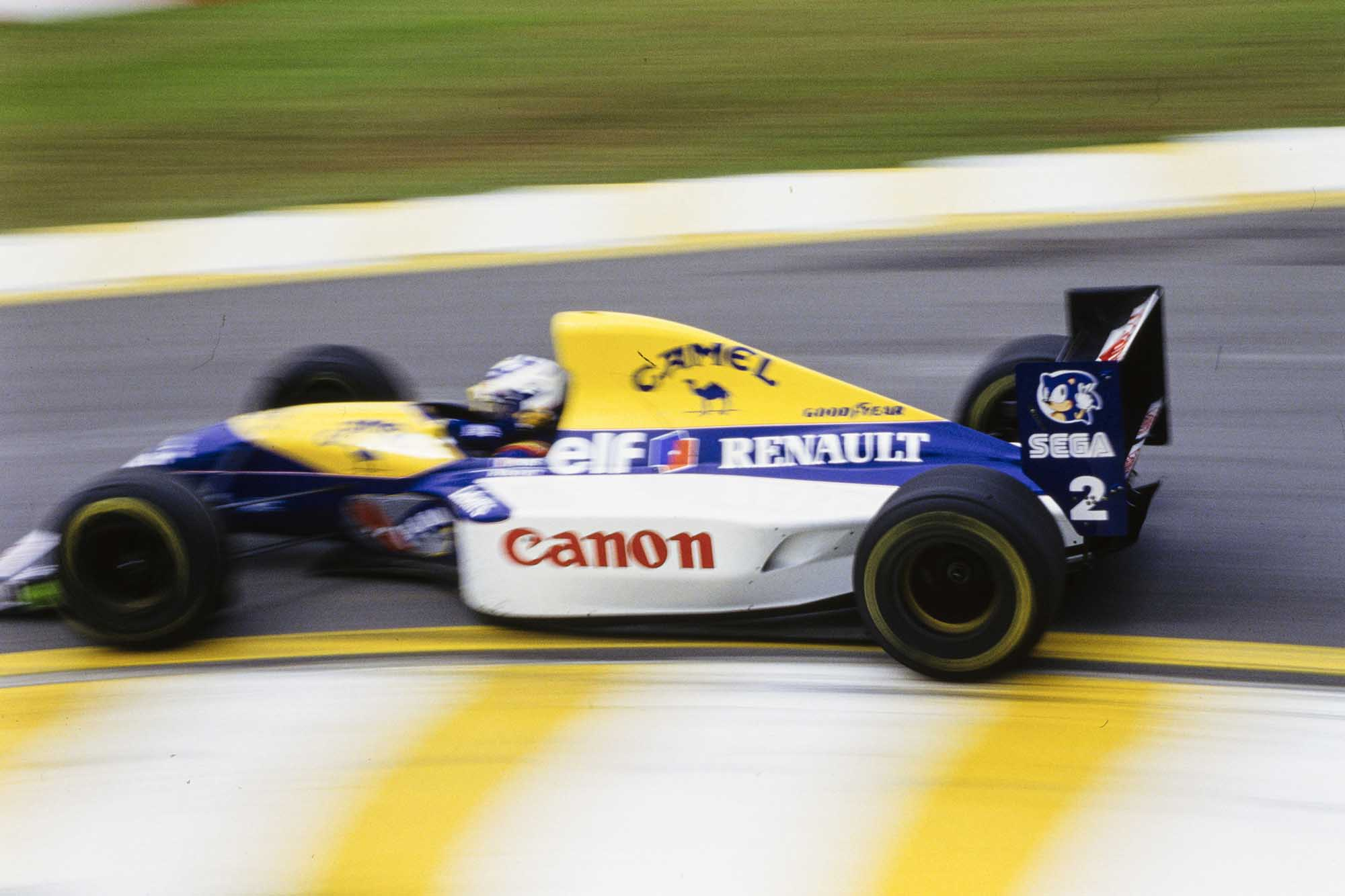 Alain Prost rounds the first corner at 1993 Brazil Grand Prix