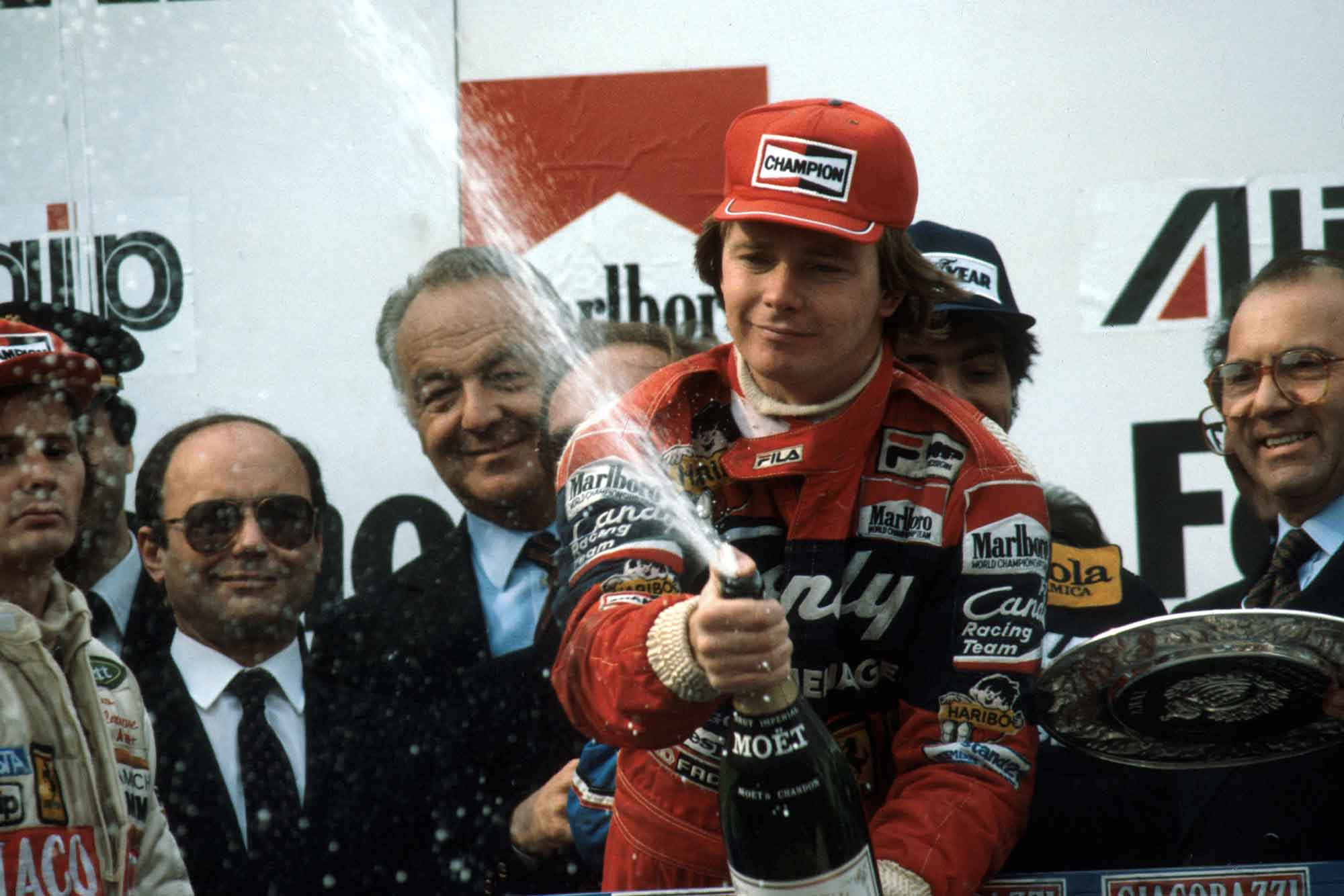 Didier Pironi celebrates on the podium after winning the 1982 San Marino Grand Prix Imola