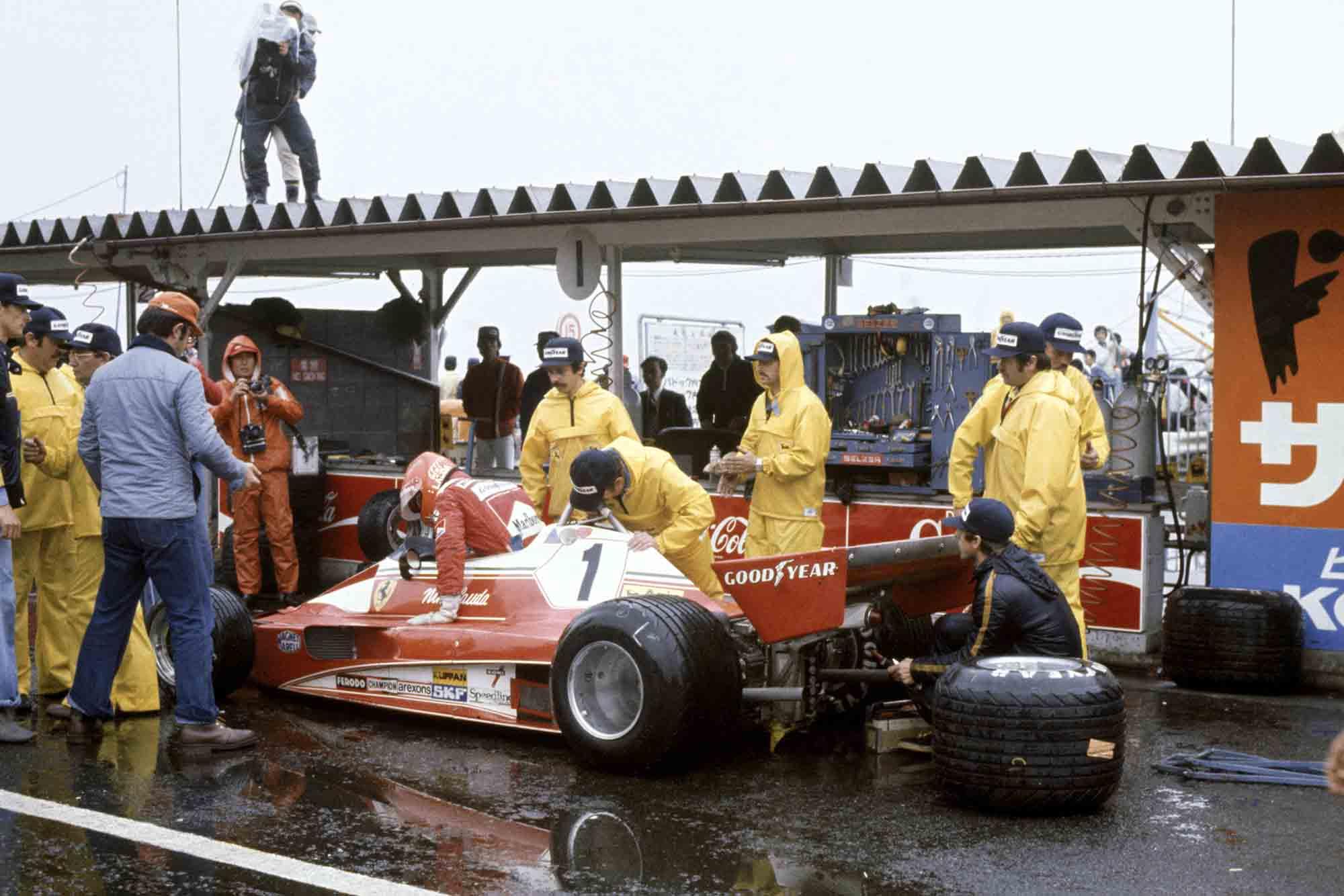 Niki Lauda climbs from his Ferrari, forfeiting the 1976 Japanese Grand Prix
