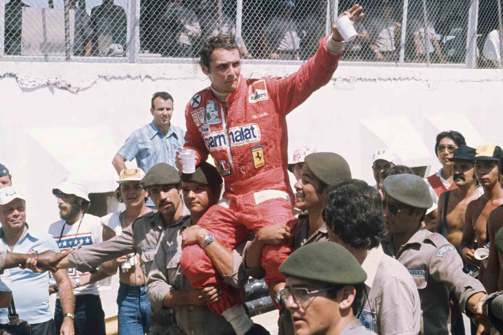 Niki Lauda is held aloft by Brazilian soldiers after winning the 1976 Brazilian Grand Prix for Ferrari