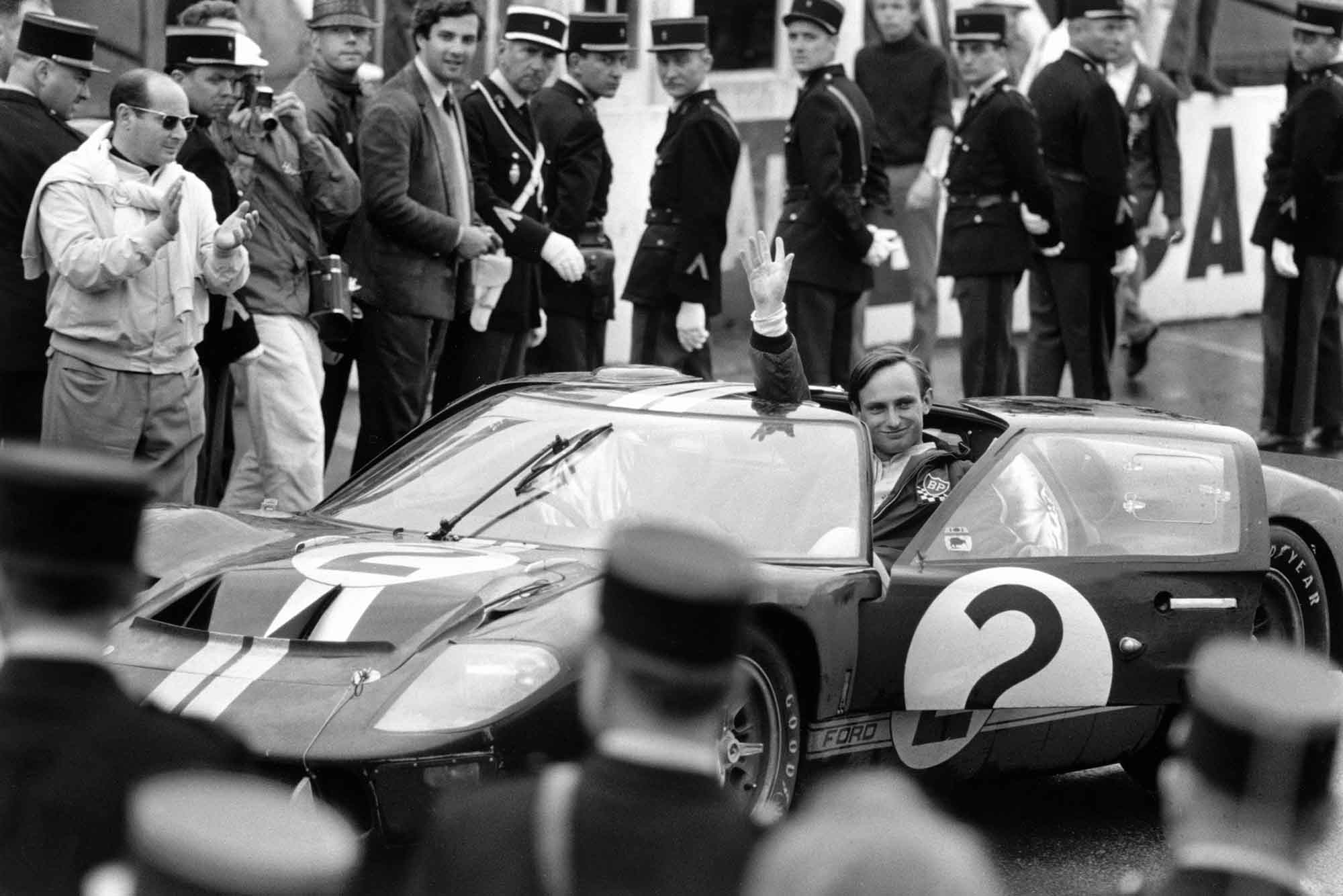 Chris Amon waves to the crowd after winning 1966 le Mans in his Ford Gt40 MkII