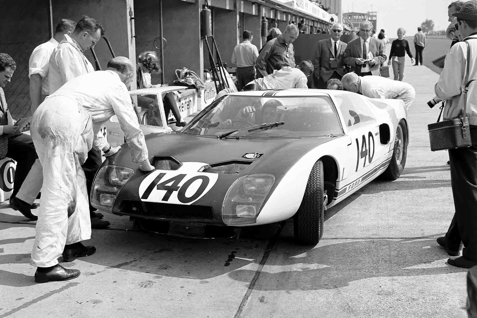 1964 Nurburgring 1000 Kms Nurburgring, Germany. 31st May 1964 The Ford GT40 (on its race debut) of Phil Hill and Bruce McLaren is worked on in the pits.
