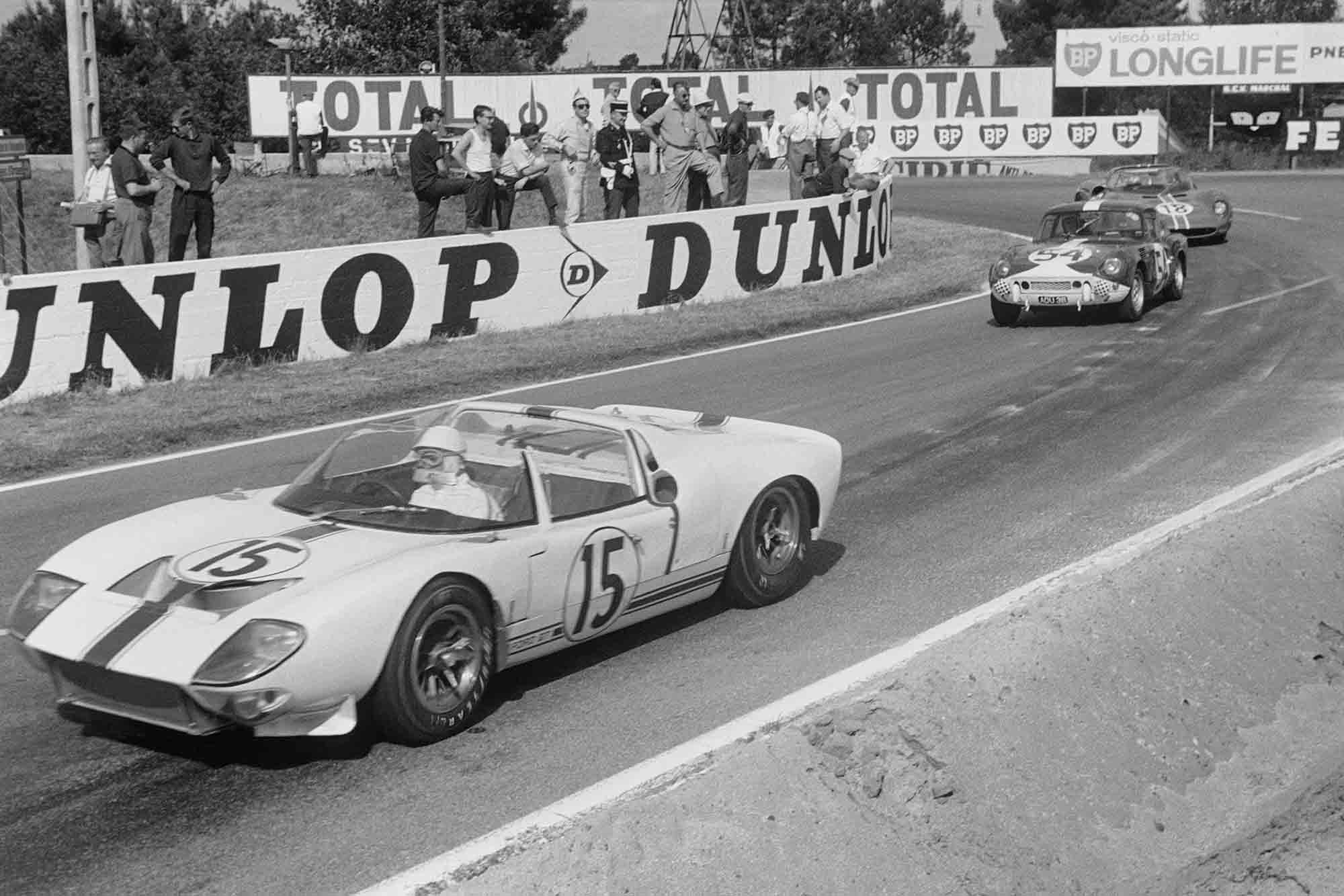 Le Mans, France. 19th - 20th June 1965 Maurice Trintignant/Guy Ligier (Ford GT40 spyder), retired, leads Claude Dubois/Jean-Francois Piot (Triumph Spitfire), 14th position, action.