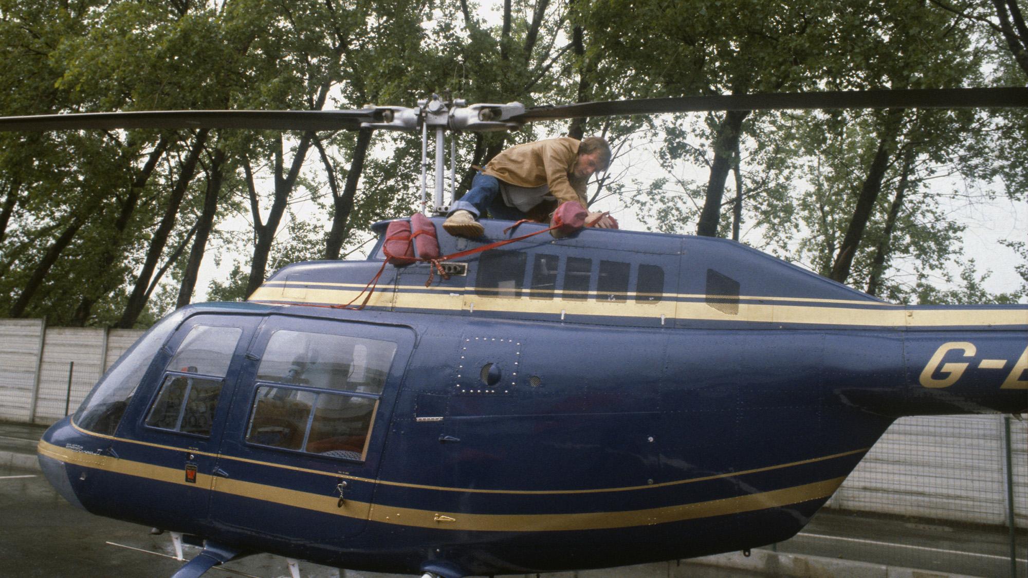 Gilles Villeneuve works on his helicopter