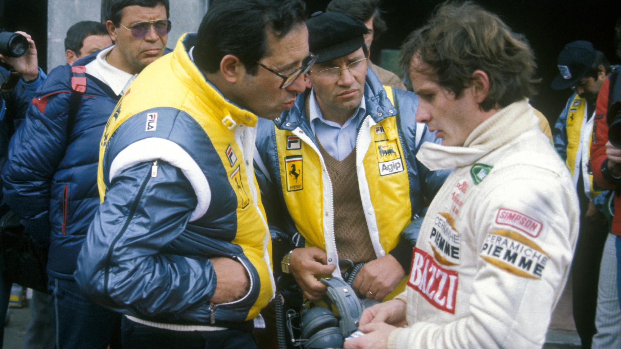 Mauro Forghieri speaks to Gilles Villeneuve ahead of practice at Zolder for the 1982 Dutch Grand Prix