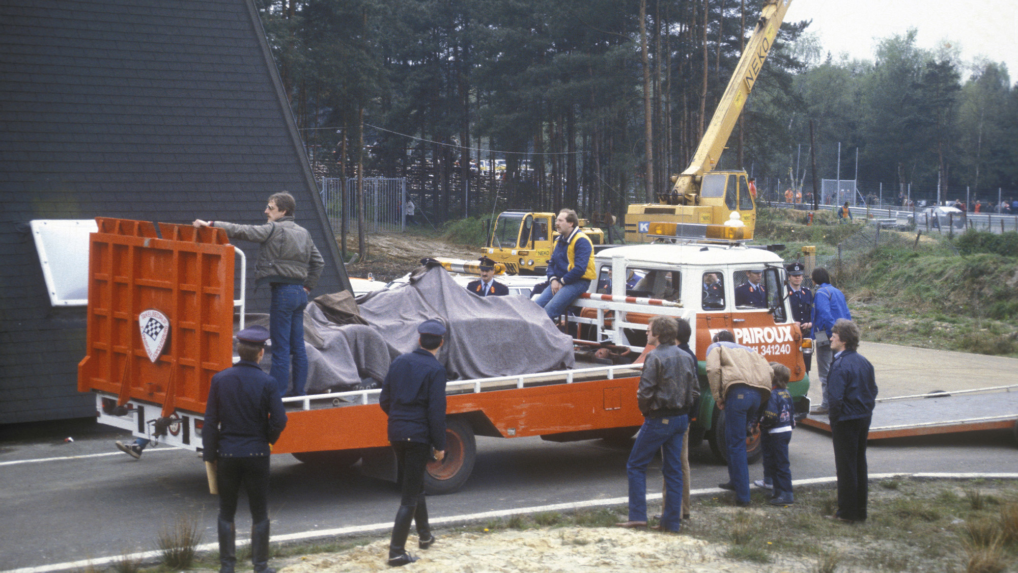 Gilles Villeneuves wrecked Ferrari is removed from the Zolder circuit in 1982