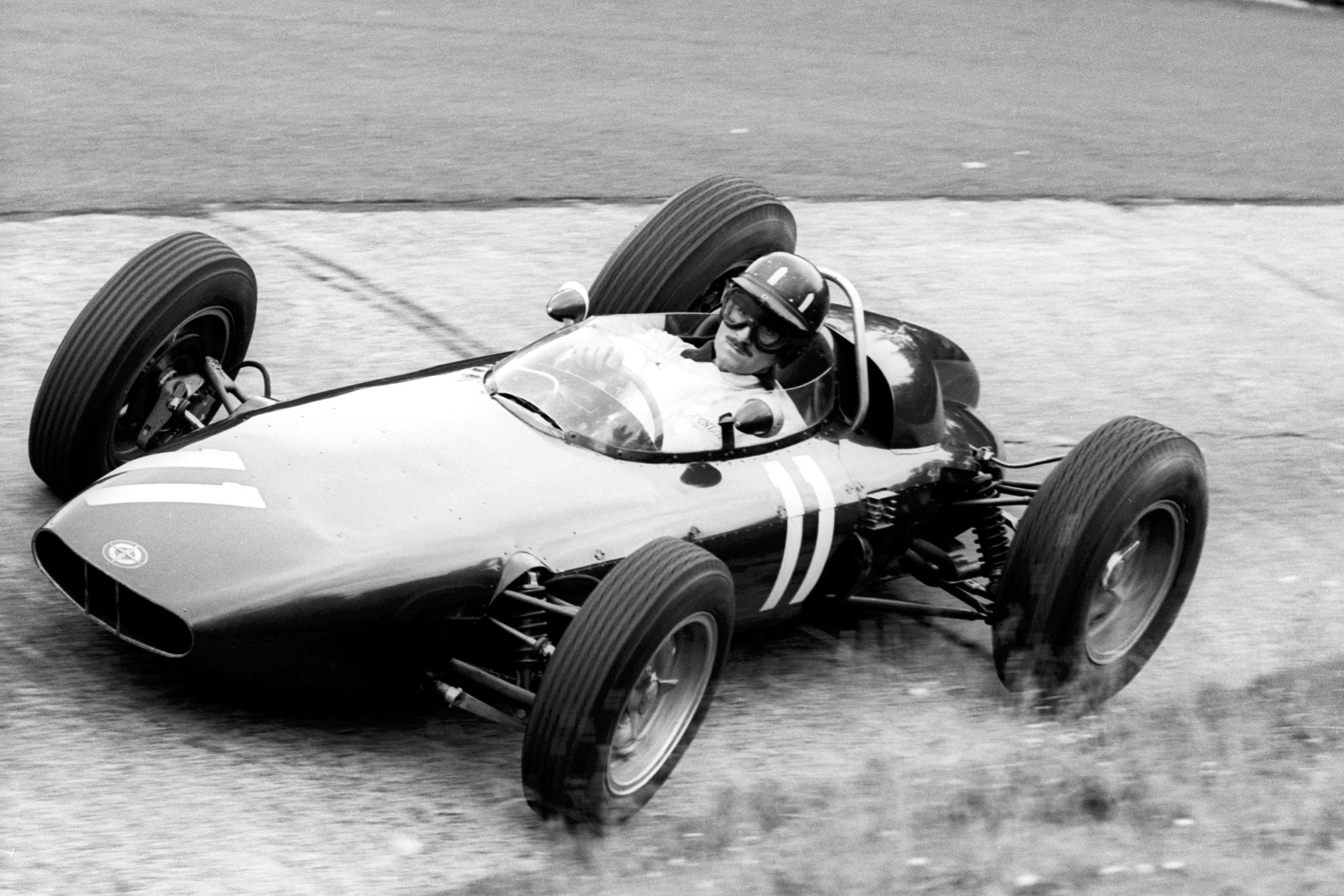 Hill put in a masterful performance in his BRM to win
