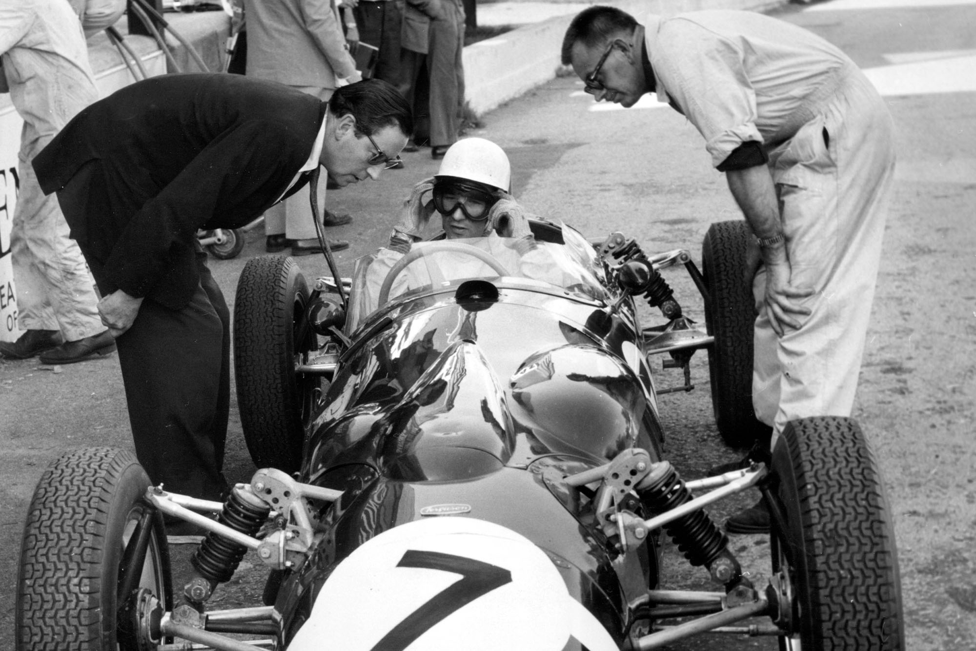 1961 Ferguson P99, Stirling Moss in pits with APR Rolt and Alf Francis. Creator: Unknown. (Photo by National Motor Museum/Heritage Images via Getty Images)