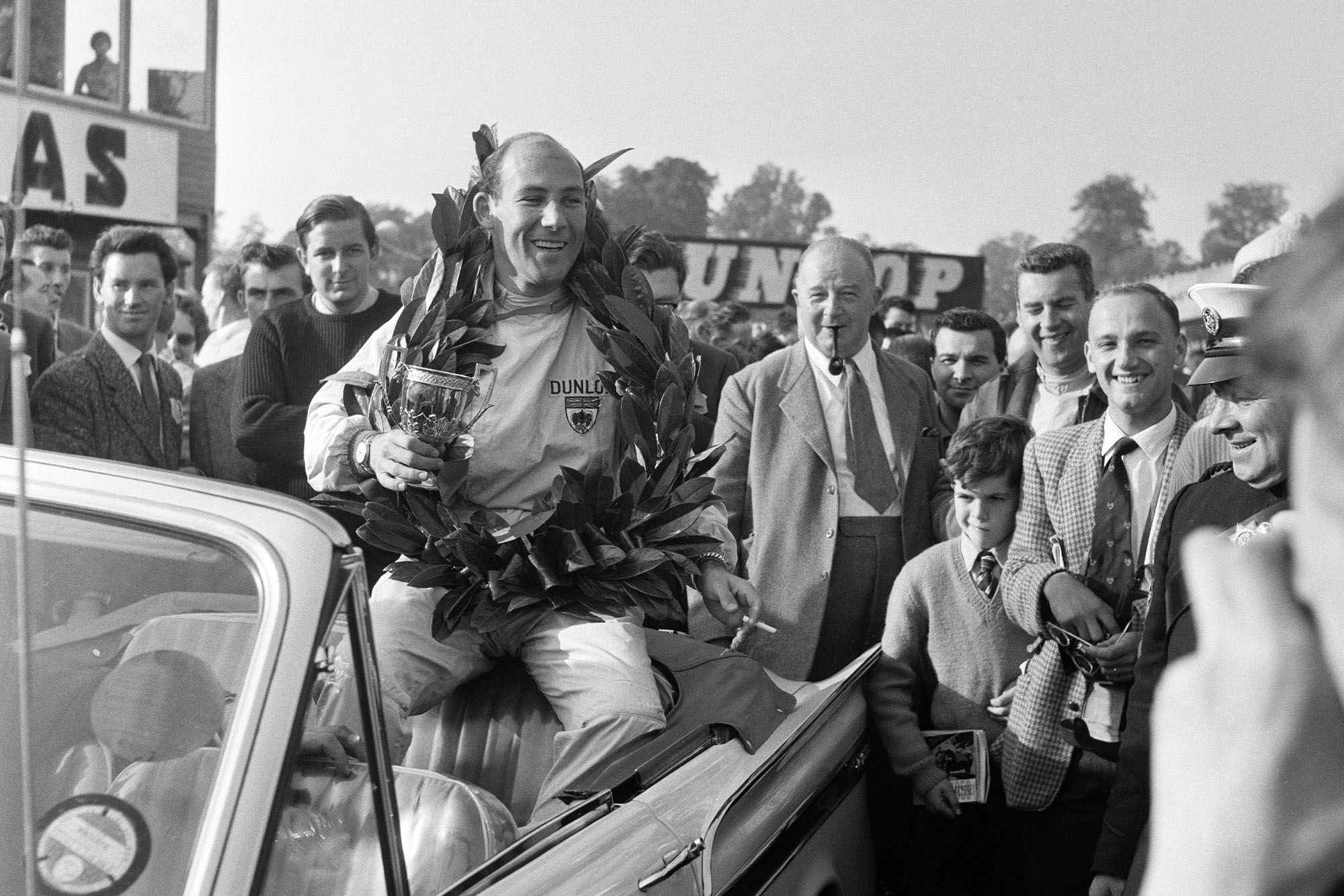 Stirling Moss, driving a Lotus-Climax, wins the Gold Cup race at Oulton Park, Cheshire, 24th September 1960. (Photo Bob Rendle/Mirrorpix/Getty Images)