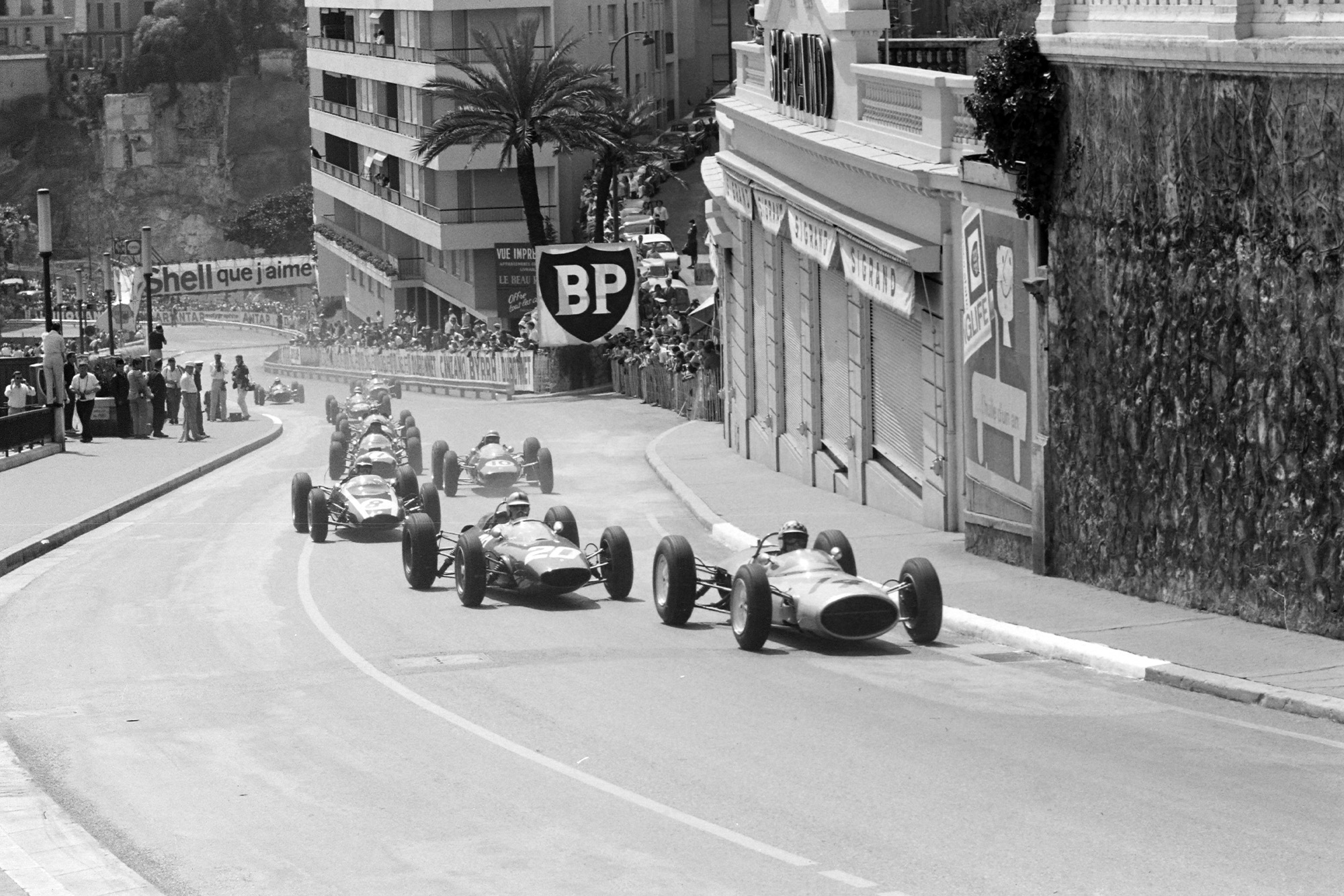 Innes Ireland, Lotus 24 BRM, leads Willy Mairesse, Ferrari 156/63,and Tony Maggs, Cooper T66 Climax, on the opening lap.