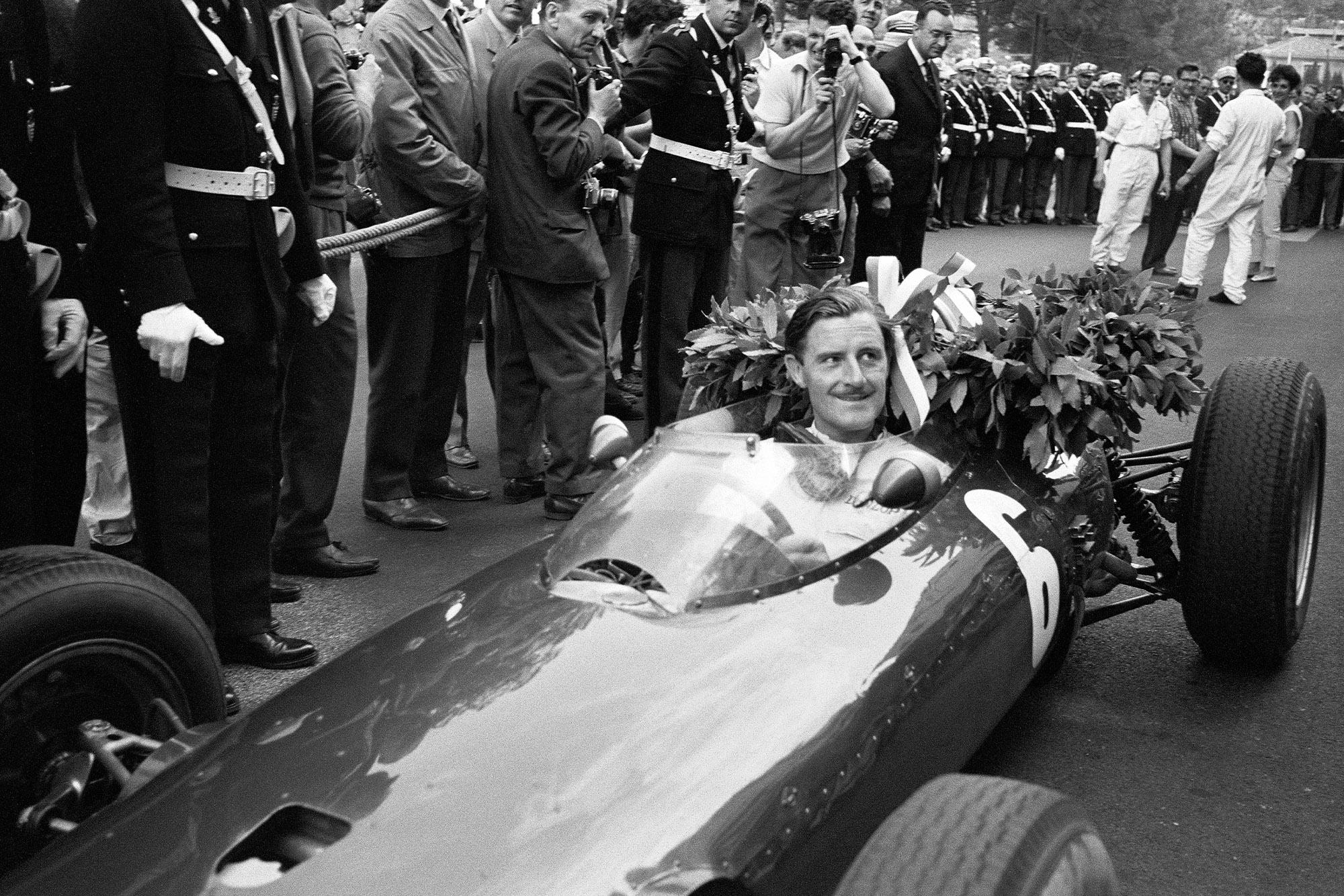 Graham Hill, BRM P57, celebrates victory.