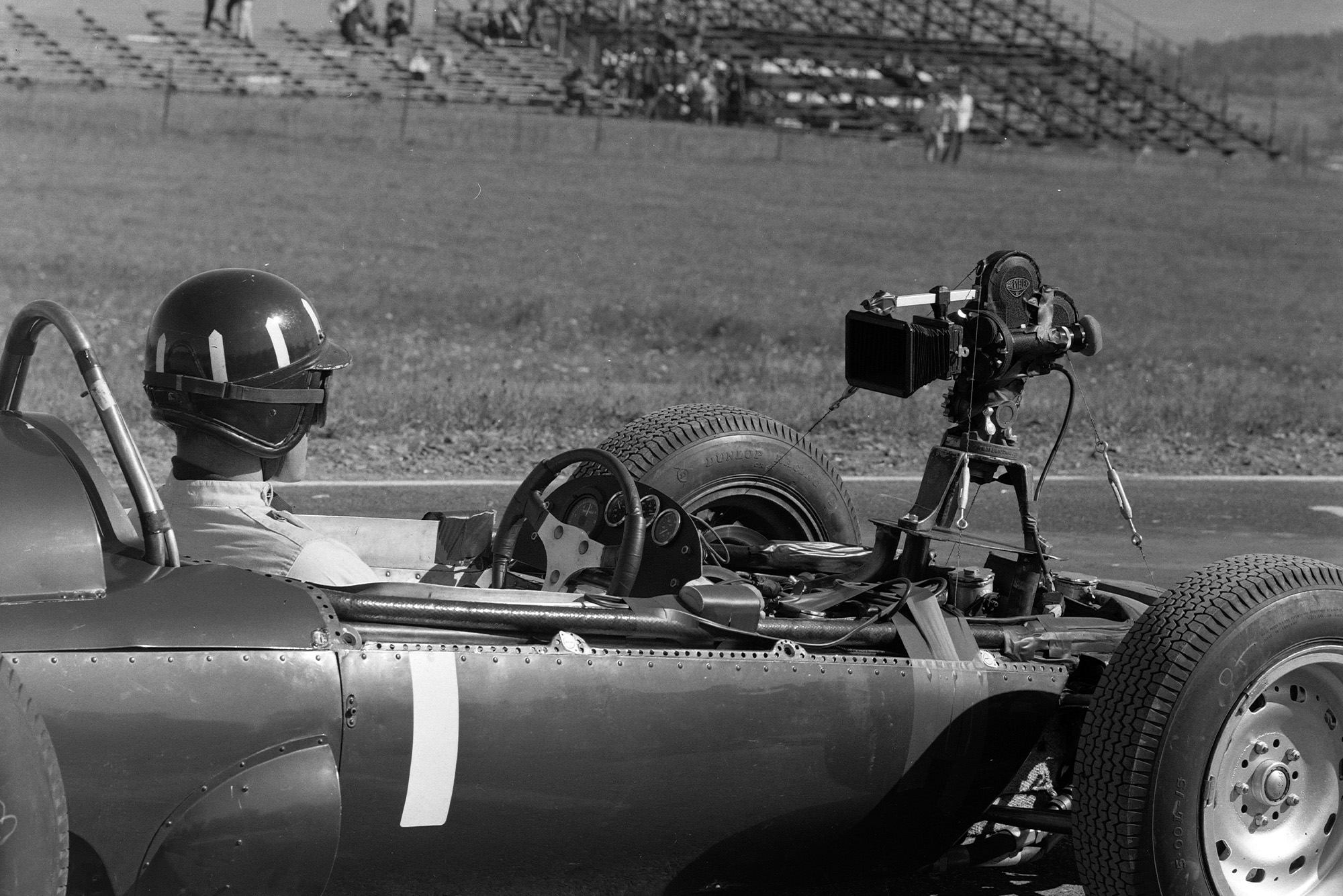 Graham Hill, BRM P57, with a rear-facing camera attached.