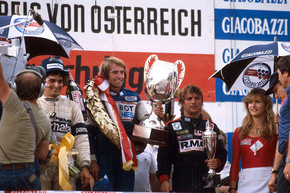 Jacques Laffite, 1st position, Rene Arnoux, 2nd position and Nelson Piquet, 3rd position on the podium.
