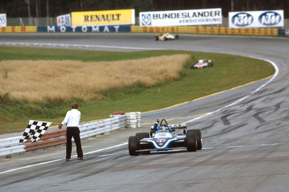 Jacques Laffite in his takes the chequered flag Ligier JS17 Matra for the win.