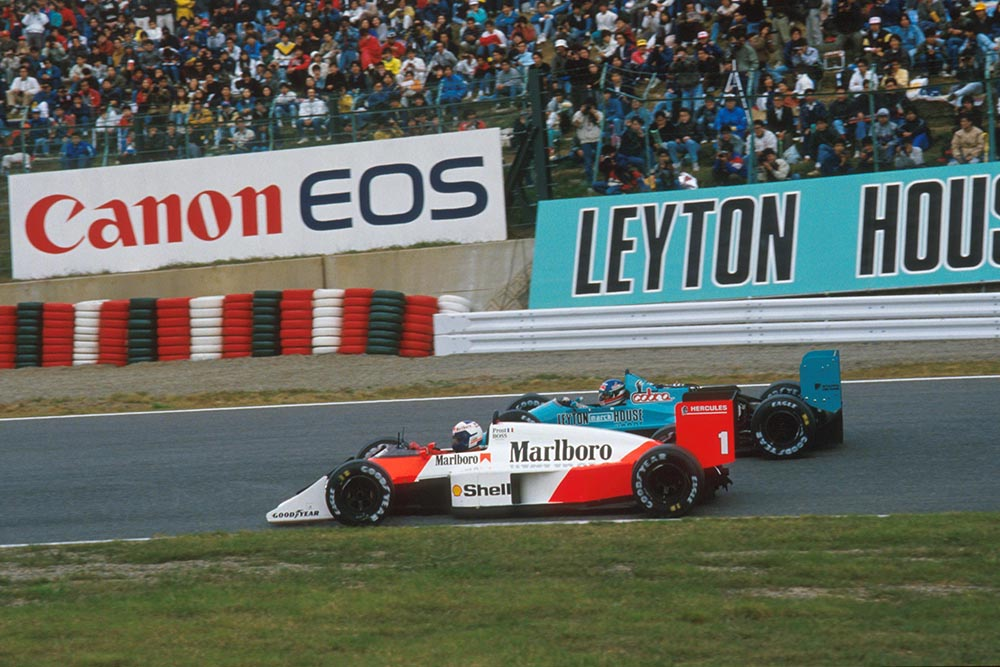 Alain Prost overtakes in his McLaren MP4/3 in the Japanese Grand Prix.