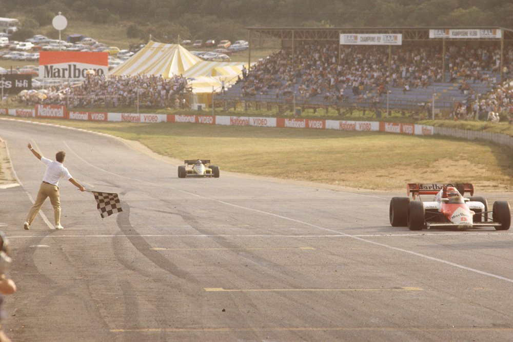 Niki Lauda (McLaren MP42 TAG Porsche) takes the chequered flag.