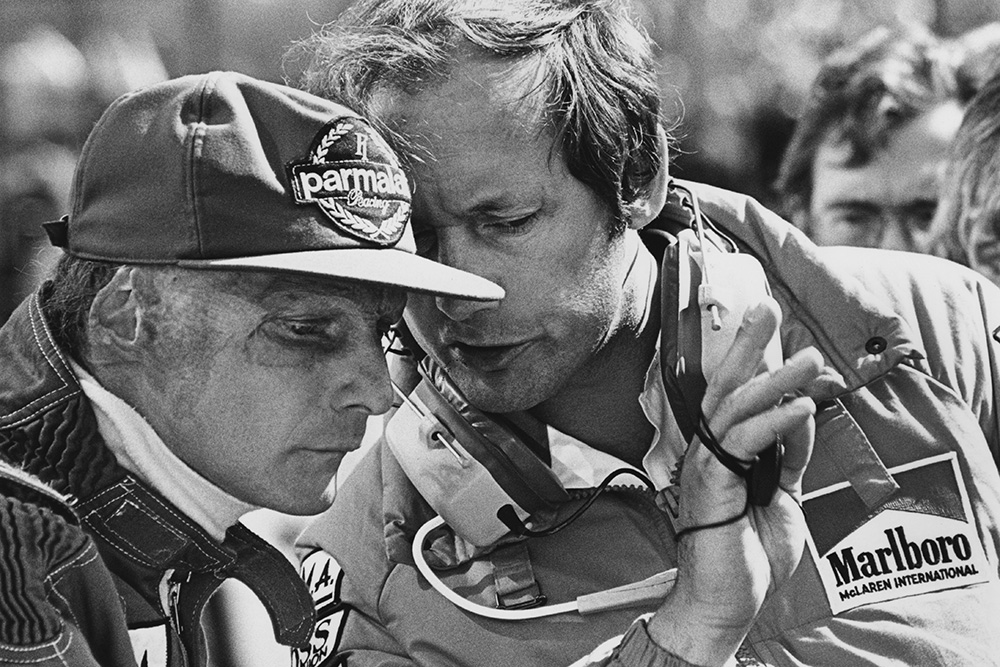 Lauda talks with team boss Ron Dennis.