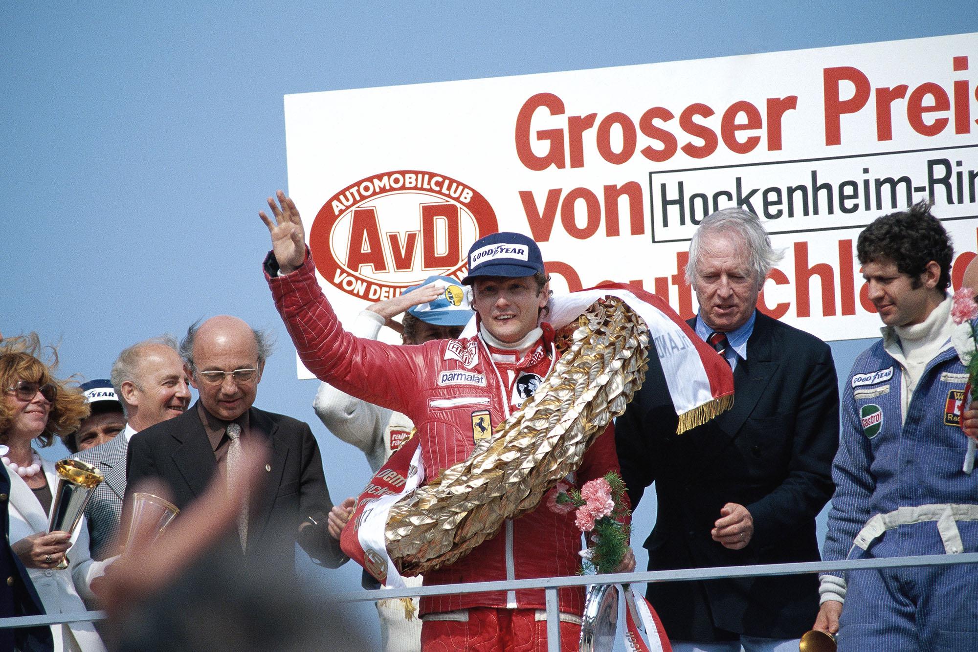 Niki Lauda waves to the crowd after winning the 1977 German Grand Prix, Hockenheim.