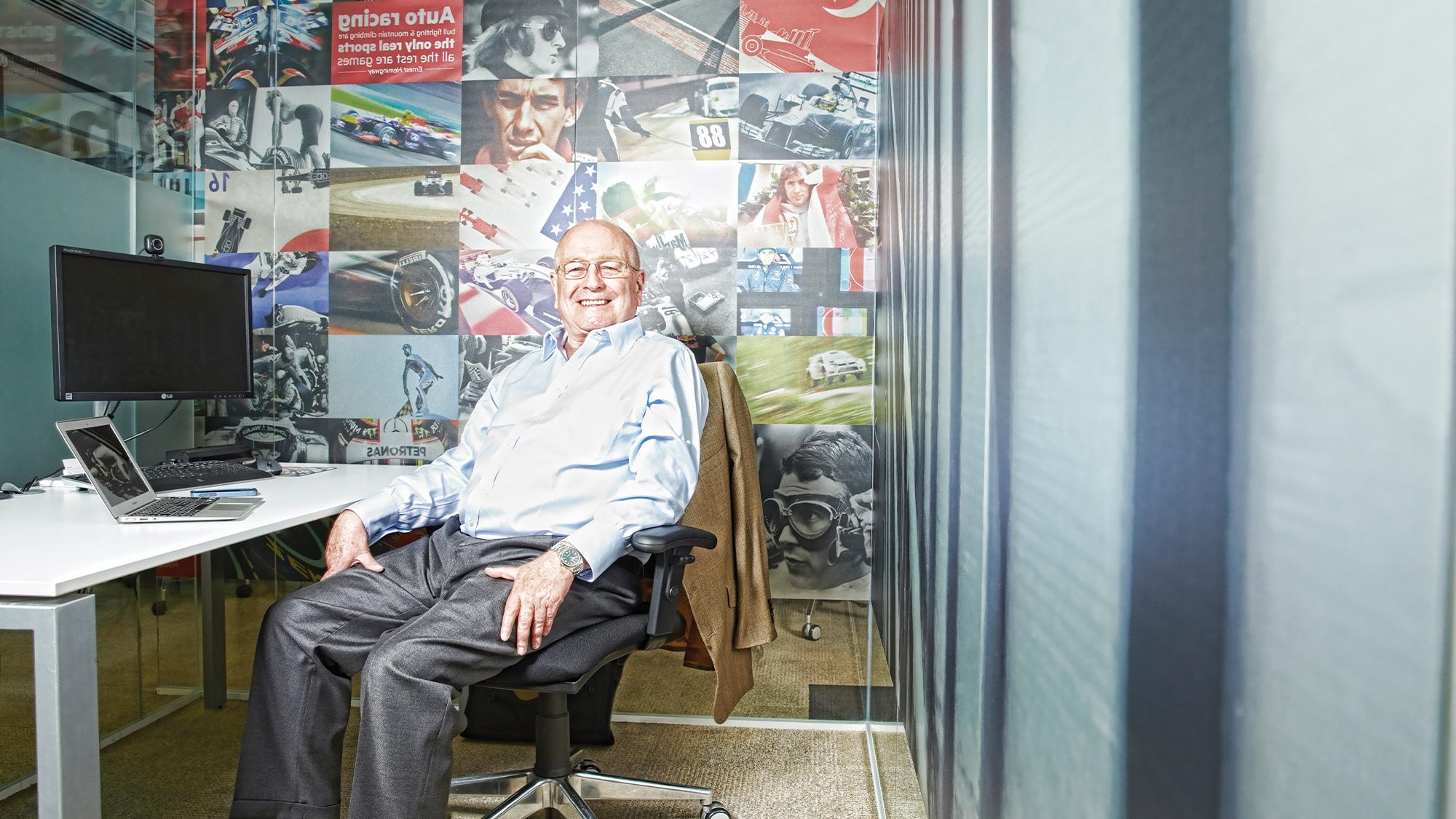 John Hogan at desk