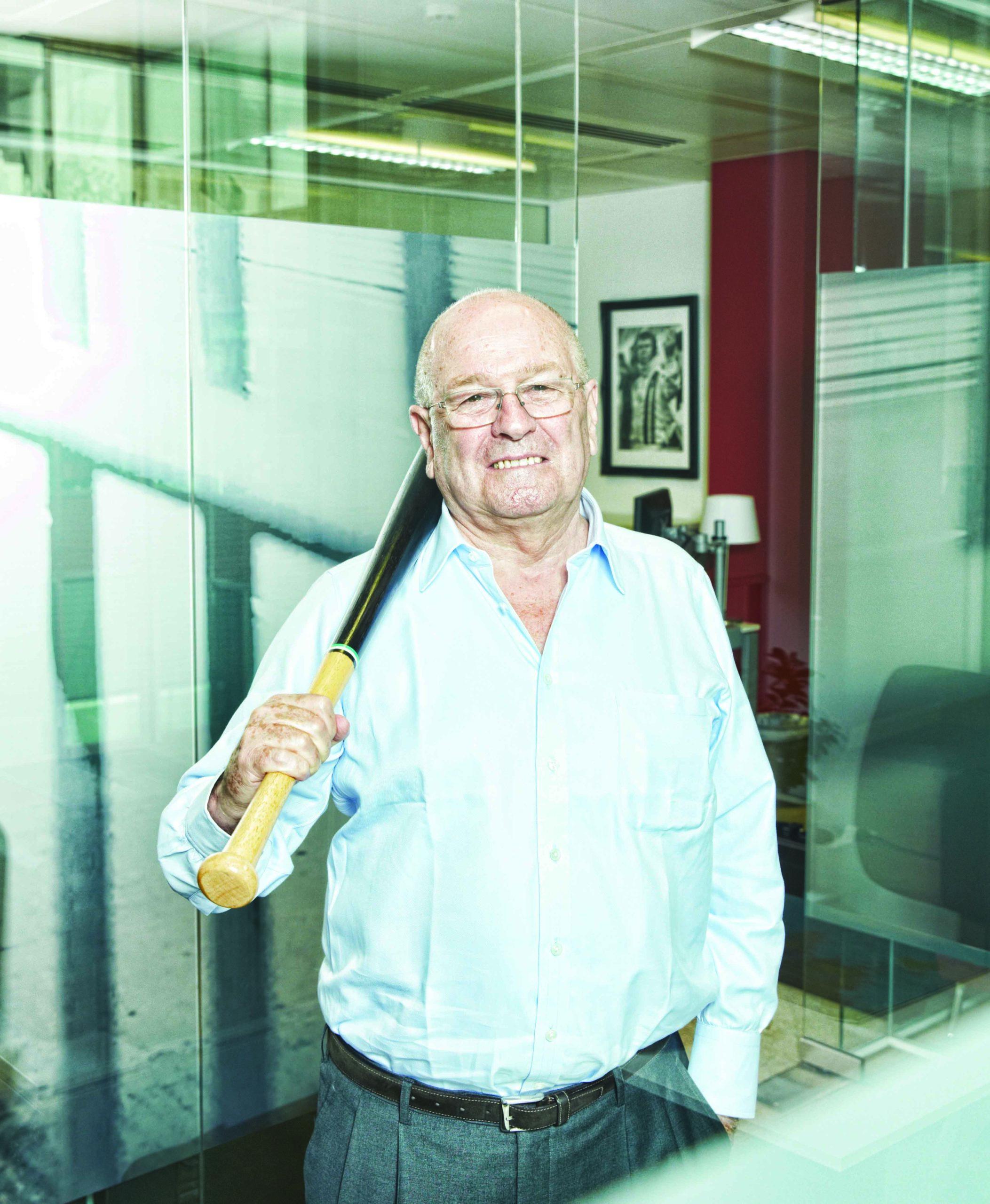 John Hogan with baseball bat
