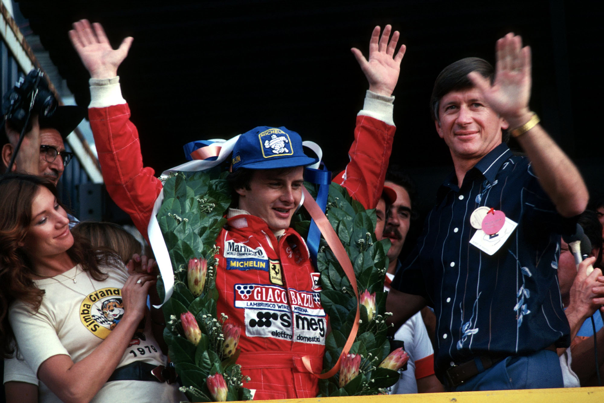 A delighted Gilles Villeneuve (Ferrari) acknowledges the crowd after winning the 1979 South African Grand Prix.