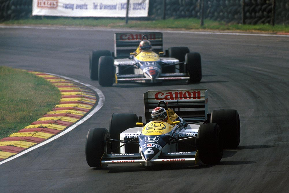 Nelson Piquet (Williams FW11) leads his team mate and race winner Nigel Mansell during an exciting race-long battle for the lead.
