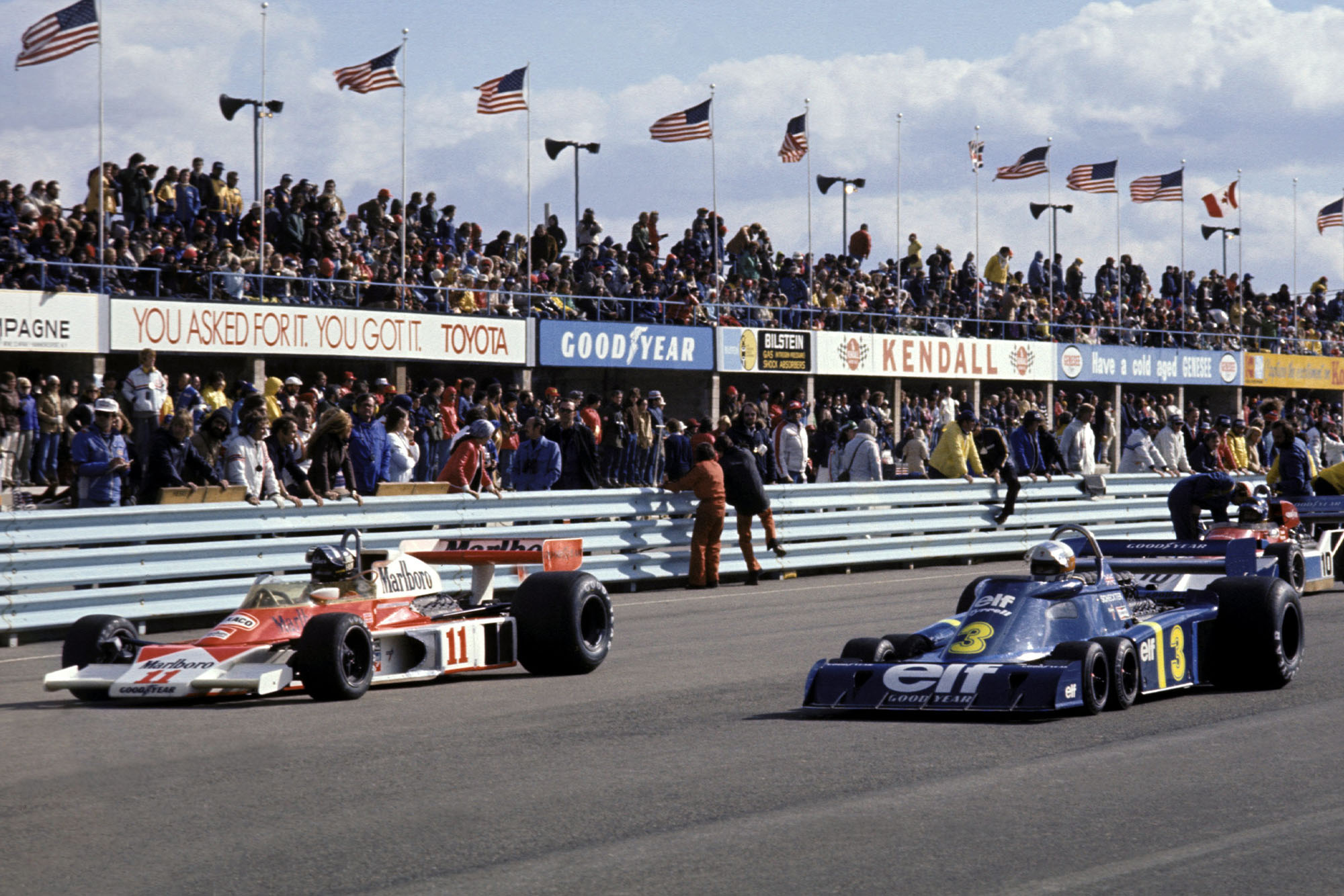 James Hunt (McLaren, left) and Jody Scheckter (Tyrrell, right) line up on the grid at the race start, United States Grand Prix East, Watkins Glen.