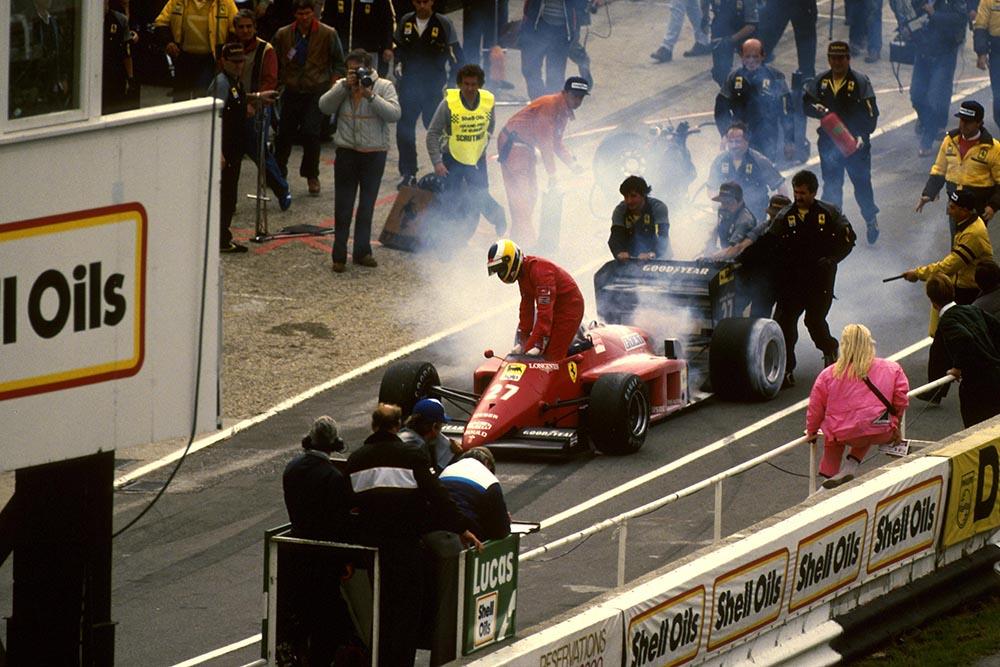 Michele Alboreto's Ferrari 156/85 goes up in smoke.