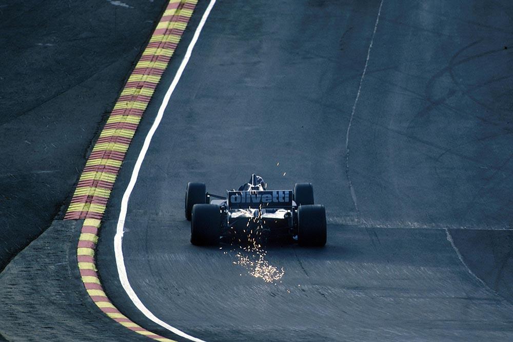 The Brabham BT54 sparks through Paddock Hill.