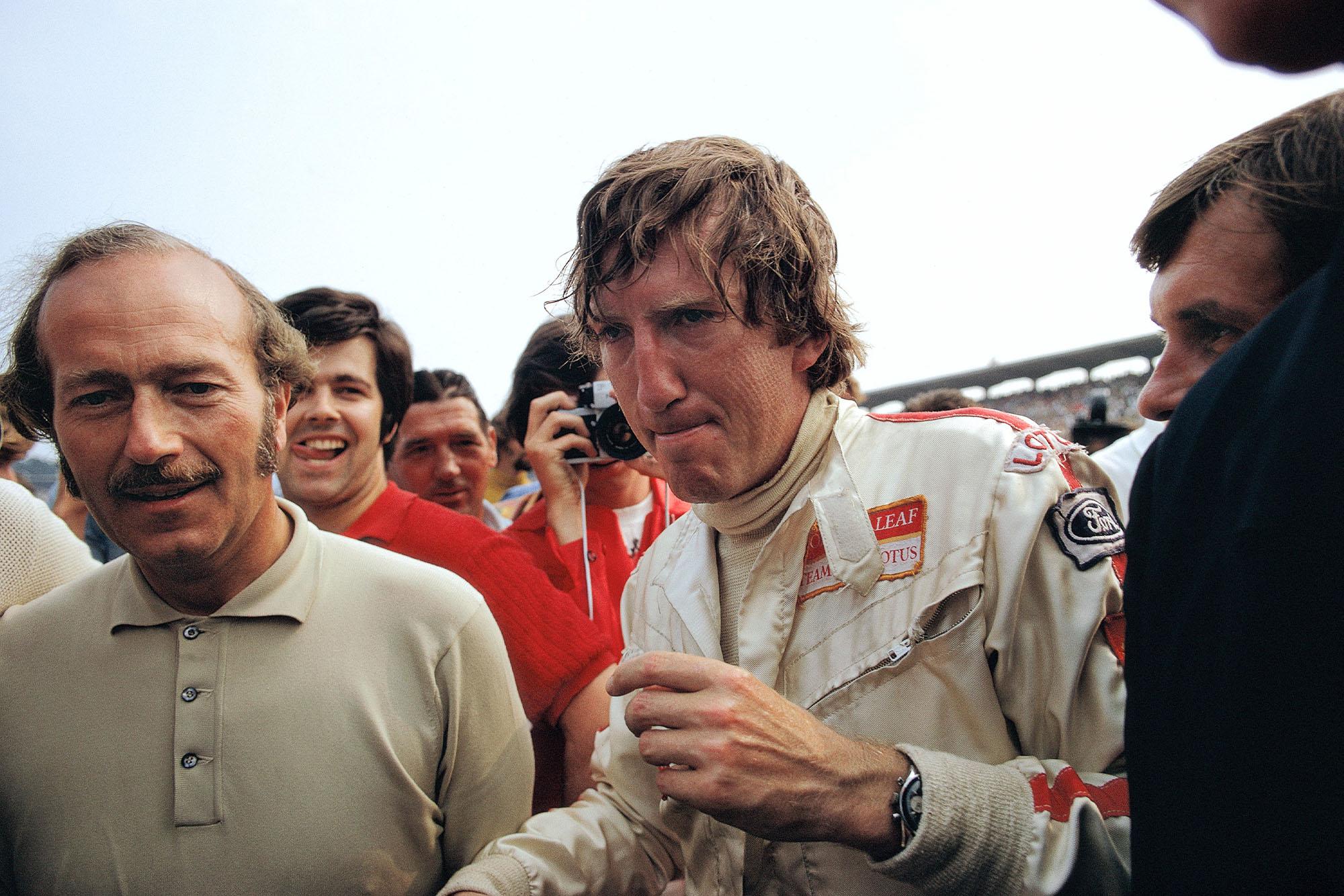 Jochen Rindt is congratulated by Lotus team boss Colin Chapman after winning the German Grand Prix.
