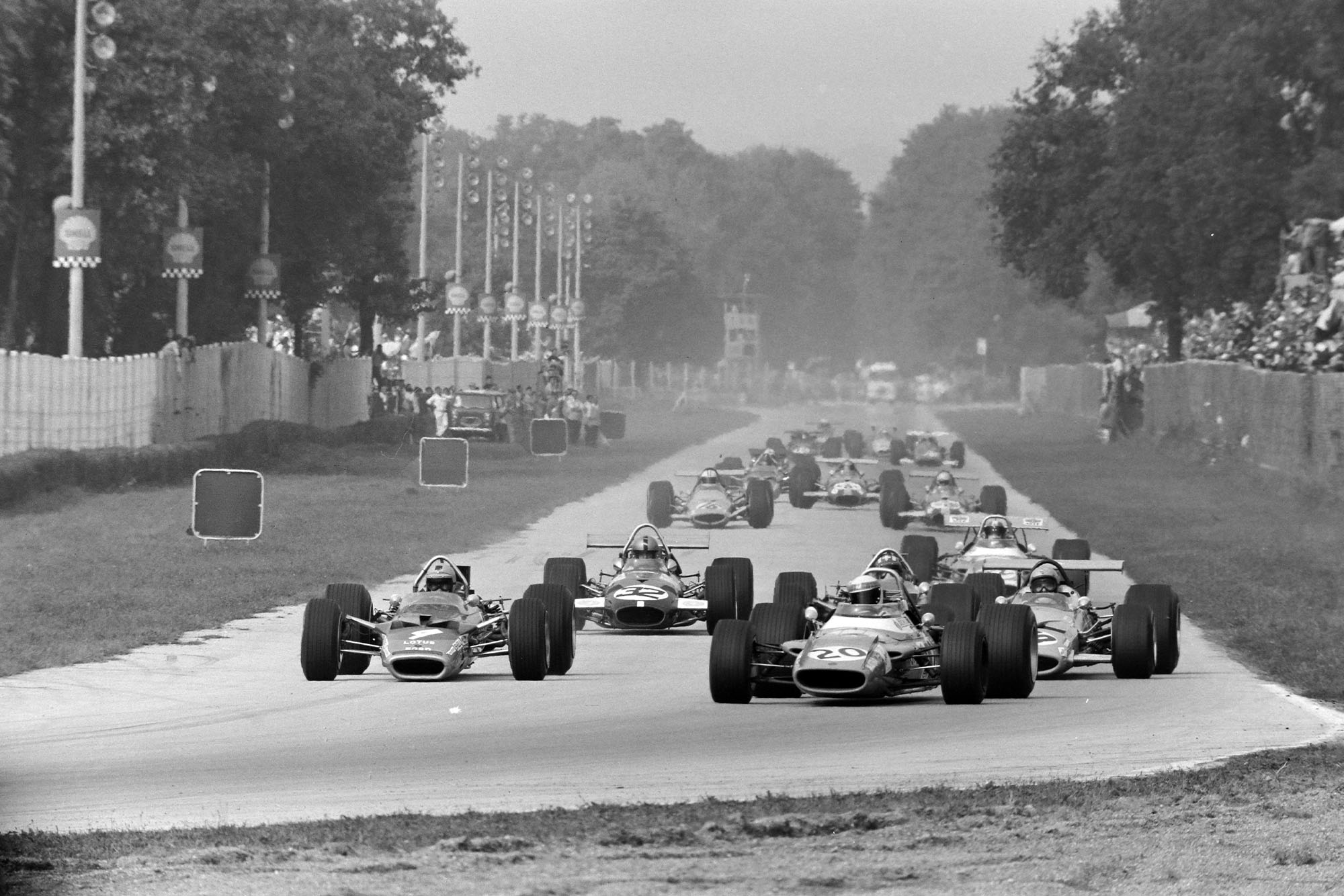 The field heads into the Curva Sud on the first lap of the 1969 Italian Grand Prix