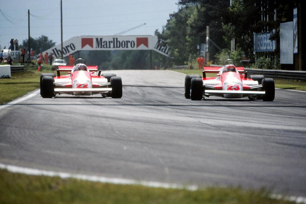 L-R: The Alfa Romeo's of Mario Andretti and Bruno Giacomelli.
