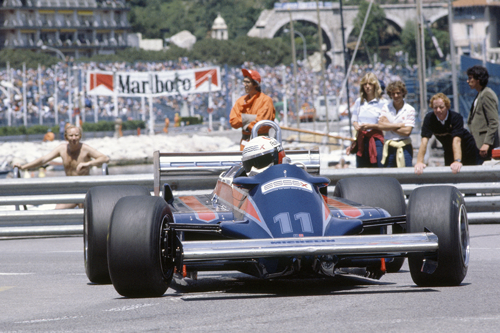 Elio de Angelis in a Lotus 87-Ford Cosworth, he later retired.